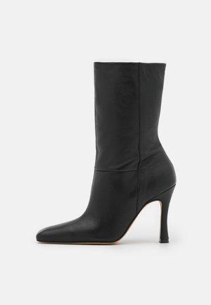 GERMEN - Classic ankle boots - black