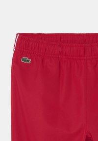 Lacoste Sport - TENNIS UNISEX - Teplákové kalhoty - ruby/white - 2