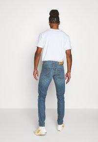 Diesel - D-STRUKT - Jeans Tapered Fit - indigo - 2