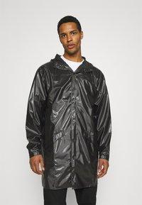 Rains - LONG JACKET UNISEX - Impermeable - shiny black - 0