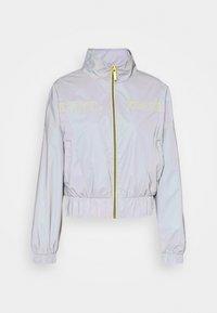 Karl Kani - RETRO SHINY SHORT TRACKJACKET - Summer jacket - grey - 7