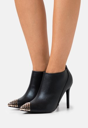 PUNK - High heeled ankle boots - black