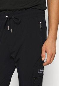 Sixth June - SLIM CARGO PANTS - Reisitaskuhousut - black - 3