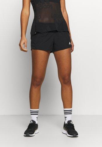RUN IT - Sports shorts - black