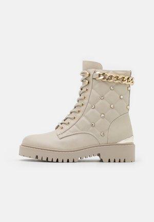 ORMOND - Platform ankle boots - vanilla