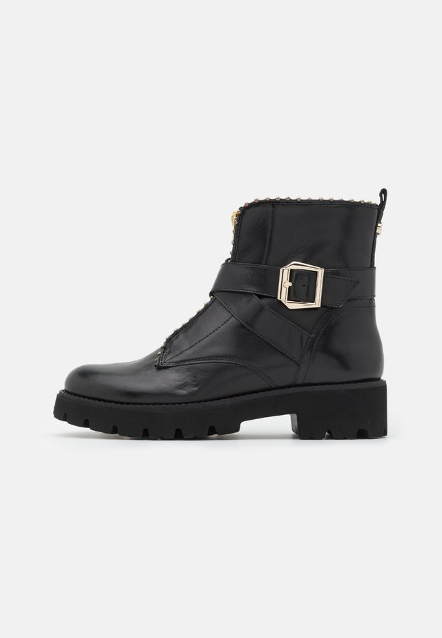 JACKY - Platform ankle boots - black