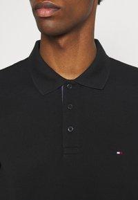 Tommy Hilfiger - CONTRAST PLACKET REGULAR - Polo shirt - black - 5
