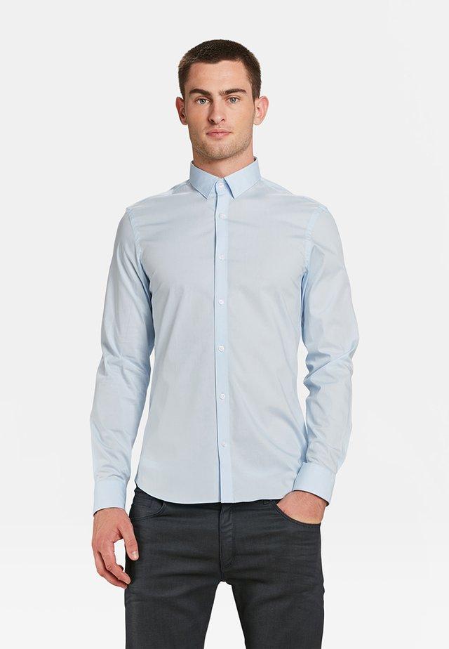 SLIM FIT STRETCH - Koszula - light blue