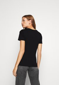 Calvin Klein Jeans - INNOVATION TEE - T-shirt con stampa - black - 2
