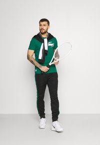 Lacoste Sport - TRACK PANT - Trainingsbroek - black/bottle green - 1