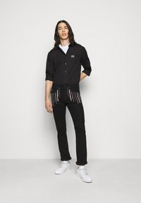Versace Jeans Couture - COAL - Džíny Slim Fit - black - 1