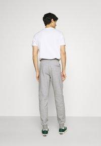 Tommy Hilfiger - MODERN ESSENTIALS PANTS - Tracksuit bottoms - medium grey heather - 2