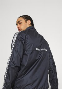 Helly Hansen - VECTOR PACKABLE ANORAK - Windbreaker - navy - 3