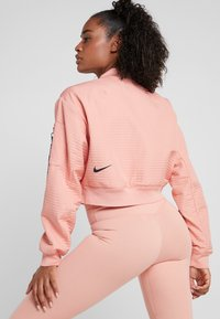 Nike Performance - TECH PACK BOMBER - Treningsjakke - pink quartz/black - 2