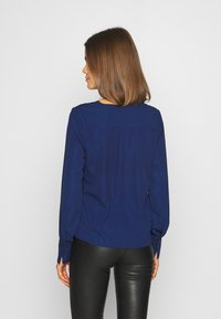 ONLY - ONLFRANCY LIFE V-NECK - Blouse - black/tiny electric leo/sodalite - 2