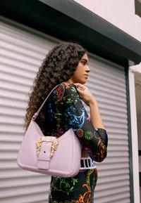 Versace Jeans Couture - BUCKLE SHOULDER BAG - Handbag - lavander - 5