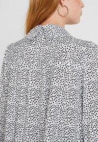 Sister Jane - POLKA RUFFLE BLOUSE - Button-down blouse - black/white - 5