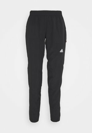 ADAPT  - Tracksuit bottoms - black