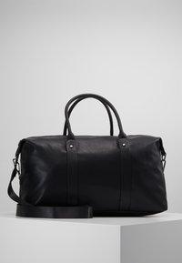 KIOMI - Weekendbag - black - 0