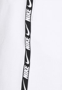 Nike Sportswear - REPEAT - Tracksuit bottoms - white/black - 3