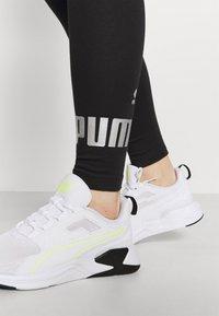 Puma - LEGGINGS - Collants - black/silver - 4