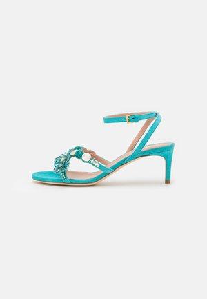 Sandaalit nilkkaremmillä - light blue