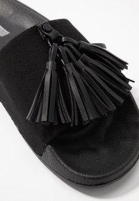 CALANDO - Mules - black - 2