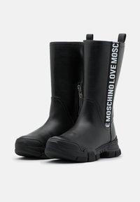 Love Moschino - TREKK - Kozačky na platformě - black - 2
