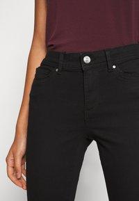 ONLY - ONLWAUW LIFE MID   - Jeans Skinny - black denim - 3