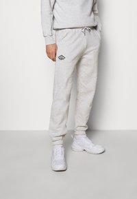 Han Kjøbenhavn - PANTS - Teplákové kalhoty - grey melange/black - 0