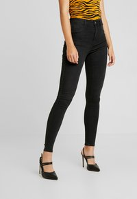 Gina Tricot - HIGHWAIST - Jeans Skinny Fit - off black - 0