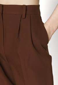 NA-KD - MATHILDE GØHLER SUIT PANTS - Trousers - dark brown - 4