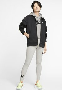Nike Sportswear - Leggings - Hosen - dark grey heather/black