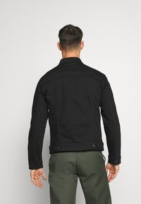 Levi's® - THE TRUCKER JACKET - Spijkerjas - blacks