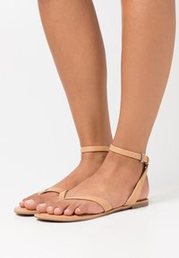 Call it Spring - SIMKOTRA - T-bar sandals - beige - 0