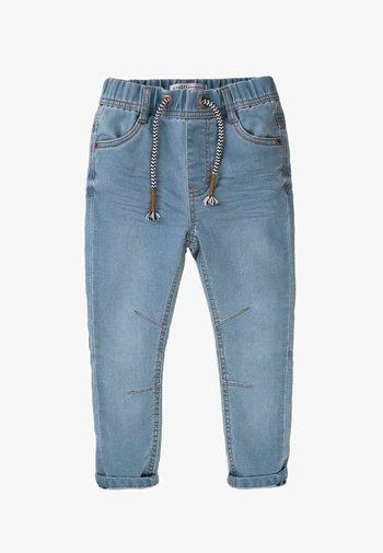 ELASTICATED KNITTED  - Slim fit jeans - light blue denim