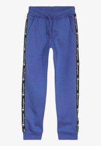 Champion - AMERICAN CLASSICS PIPING CUFF PANTS - Spodnie treningowe - royal blue - 0