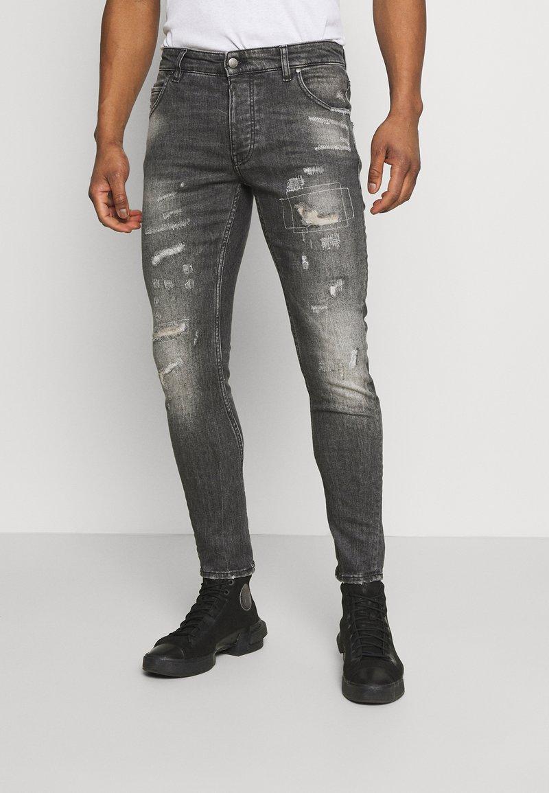 Tigha - BILLY THE KID REPAIRED - Jeans Skinny Fit - vintage black