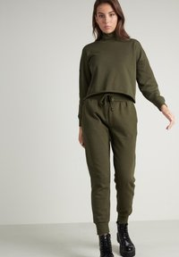 Tezenis - Tracksuit bottoms - eco green - 0
