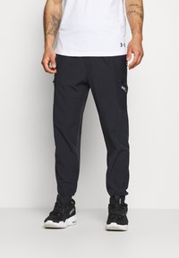 Under Armour - UA FUTURES WOVEN PANT - Pantalon de survêtement - black - 0