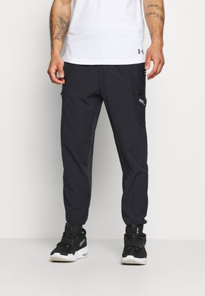 UA FUTURES WOVEN PANT - Tracksuit bottoms - black