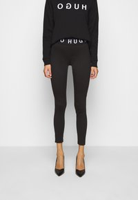 HUGO - Leggings - Trousers - black - 1