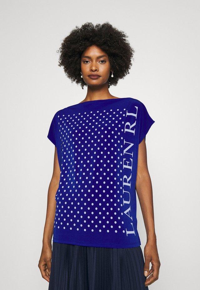 ANDRENITA - Print T-shirt - sapphire star/white