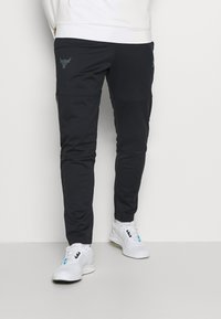 Under Armour - ROCK TRACK PANT - Pantalon de survêtement - black - 0