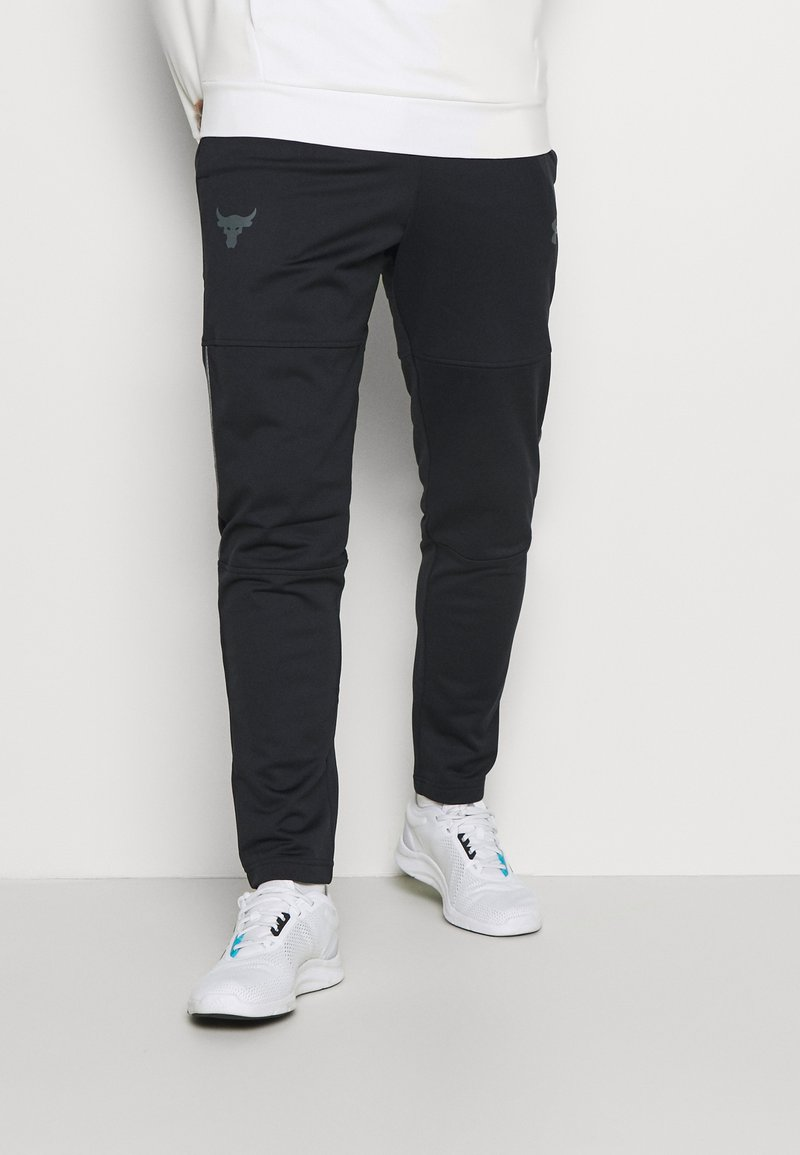 Under Armour - ROCK TRACK PANT - Pantalon de survêtement - black