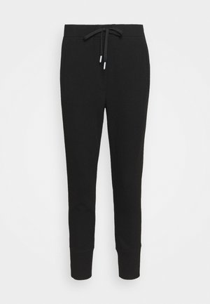 EDIGNA COZY - Tracksuit bottoms - black