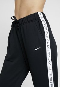 Nike Performance - DRY GET FIT - Tracksuit bottoms - black/white - 4
