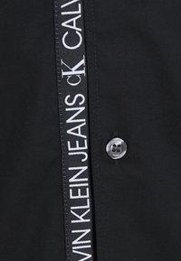 Calvin Klein Jeans - LOGO TAPE - Shirt - black - 2