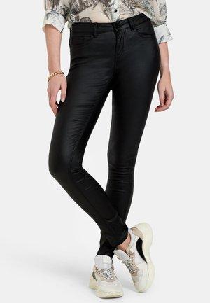 CYRA COATED BROEK - Slim fit jeans - black