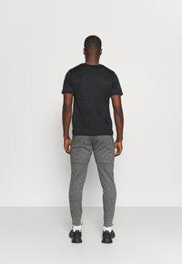 4F - Men's sweatpants - Pantalon de survêtement - grey - 2